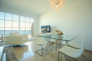 dining room with a modern and minimalist style, like all other rooms of the apartment becomes an exclusive area