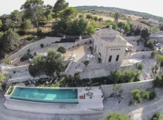 spectacular aerial view of the house which rises majestically on the top of the hill